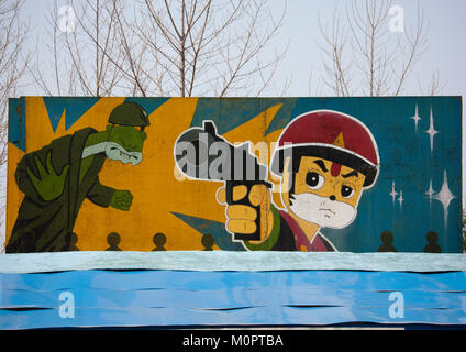 Propaganda billboard for a shooting range in Taesongsan funfair, Pyongan Province, Pyongyang, North Korea - Stock Photo