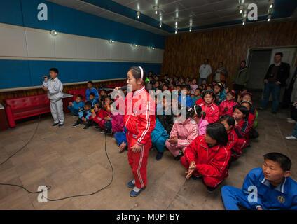 North Korean children singing during a karaoke Songdowon international children's camp, Kangwon Province, Wonsan, - Stock Photo
