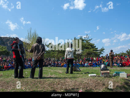 North Korean children singing in a park during a summer camp, North Hamgyong Province, Chilbo Sea, North Korea - Stock Photo