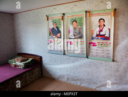 Bedroom in a North Korean house with the Dear Leaders portraits on the wall, South Hamgyong Province, Hamhung, North - Stock Photo