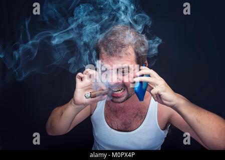 Rude smoking man yelling at his cell phone - Stock Photo