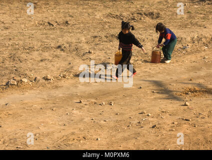 North Korean children bringing back buckets full of water from a well in the countryside, South Pyongan Province, - Stock Photo