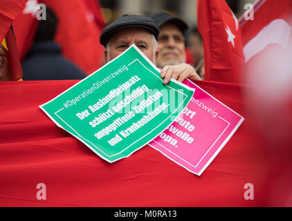 Frankfurt am Main, Germany. 24th Jan, 2018. A protester holding a sign with the text 'The operation abroad protects - Stock Photo