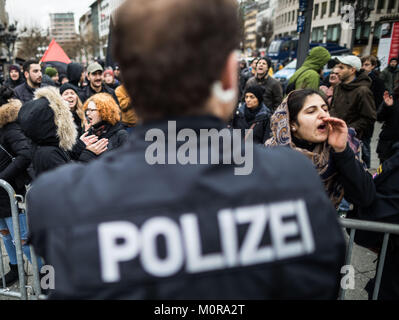 Frankfurt am Main, Germany. 24th Jan, 2018. Counter-protesters standing behind a police barrier during a rally in - Stock Photo