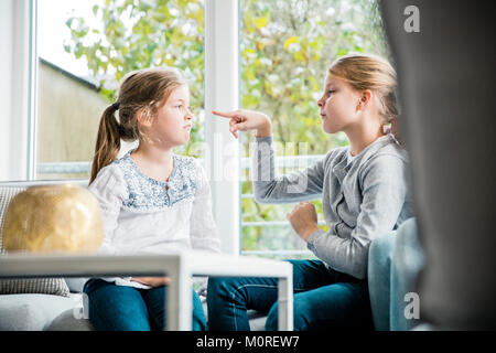 Two girls having a dispute - Stock Photo