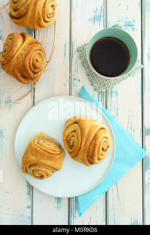 Home-baked Franzbroetchen and cup of coffee - Stock Photo