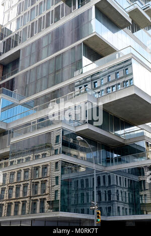 USA, New York City,  High-rise building, 56 Leonard Street, Facade with reflections - Stock Photo