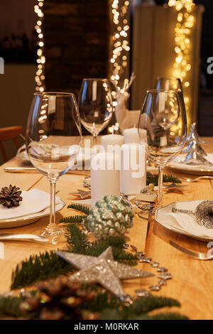Festively decorated table for Christmas - Stock Photo