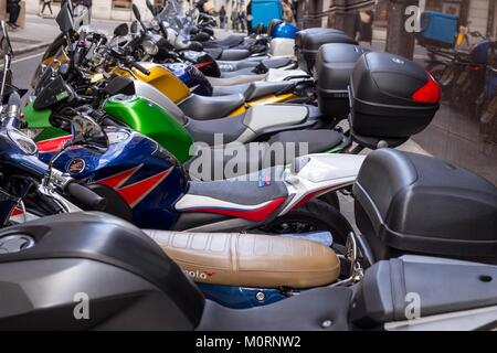 A row of parked motorbikes in central London - Stock Photo