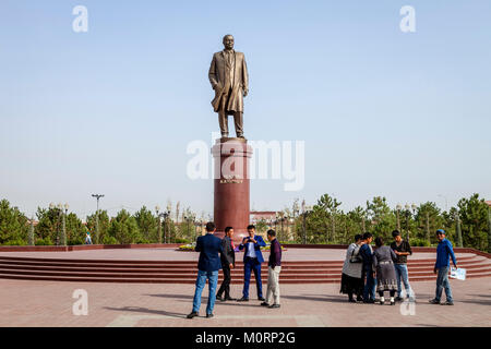 Uzbek People Pose For A Photo Under The Statue Of Islam Karimov, Samarkand, Uzbekistan - Stock Photo
