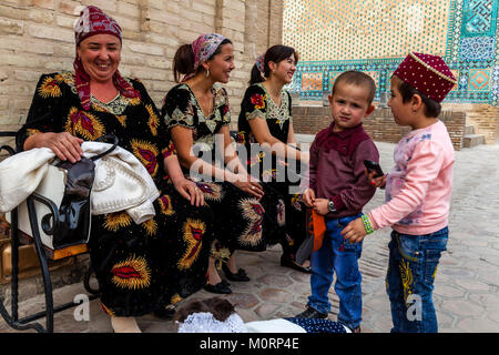 Uzbek Families Visiting The Shah-i-Zinda Mausoleum Complex, Samarkand, Uzbekistan - Stock Photo