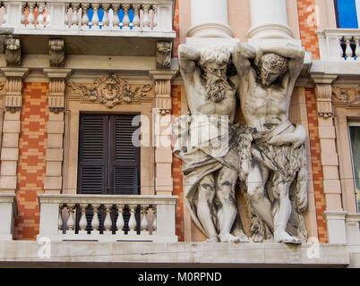 Marble ornamental statues on the facade of a historic building in the center of Genoa (Genova), italy. - Stock Photo