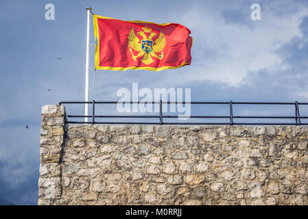 Montenegrin flag on Forte Mare fortress in Herceg Novi city on the Adriatic Sea coast in Montenegro - Stock Photo