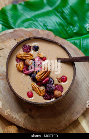 Chocolate smoothie with frozen berries and nuts - Stock Photo