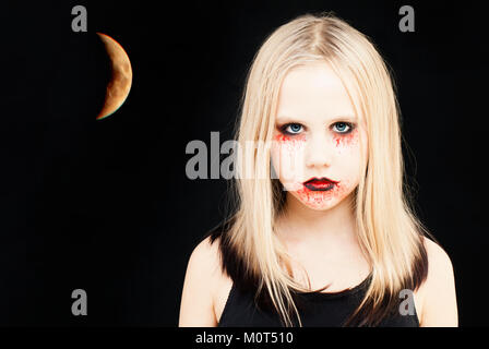 Girl with Halloween Makeup. Portrait of Teen Girl with Artistic Make up and Moon on Black Background - Stock Photo
