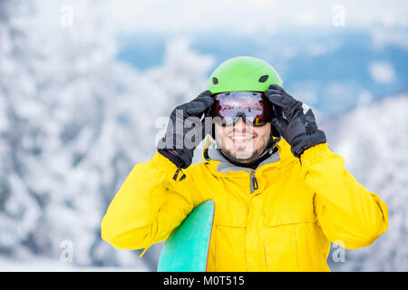 Man wearing sports glasses outdoors