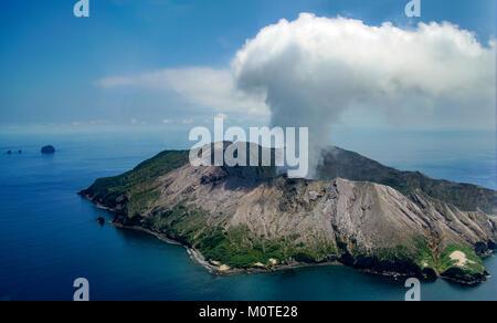 Approaching White Island / Whakaari volcano by helicopter. Bay off Plenty, North Island, New Zealand. Whakaarian - Stock Photo