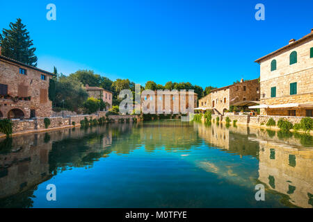 Bagno Vignoni village medieval thermal baths or hot pool. Tuscany, Italy, Europe - Stock Photo
