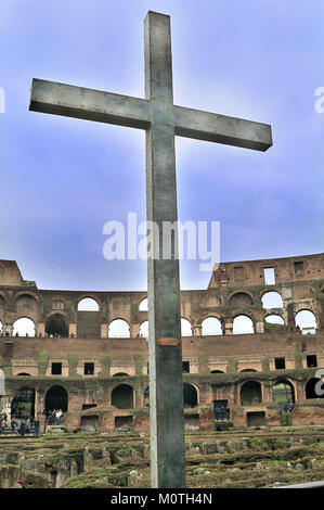Cross in the Colosseum, Rome, Italy - Stock Photo