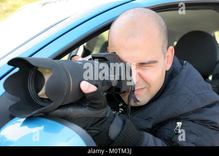 Professional photographer in action with telephoto lens, paparazzi - Stock Photo