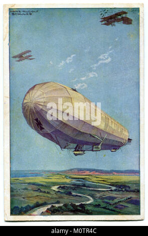Old German postcard 'The German air fleet', a huge Zeppelin airship with two military airplanes flying in the air - Stock Photo