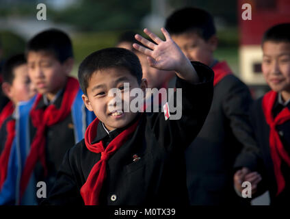 North Korean pioneer boy waving hand, Pyongan Province, Pyongyang, North Korea - Stock Photo