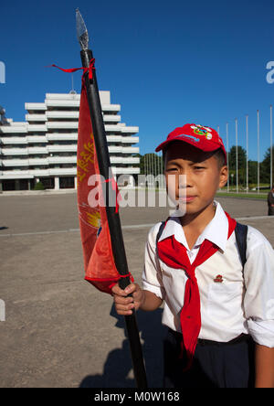 North Korean pioneer holding a flag in Songdowon international children's camp, Kangwon Province, Wonsan, North - Stock Photo
