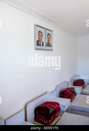 Bedroom with the official portraits of the Dear Leaders in Songdowon international children's camp, Kangwon Province, - Stock Photo