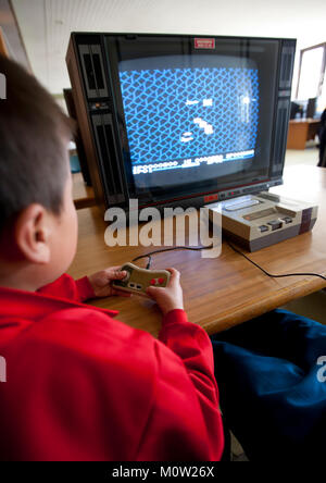 North Korean child playing video games in Songdowon international children's camp, Kangwon Province, Wonsan, North - Stock Photo