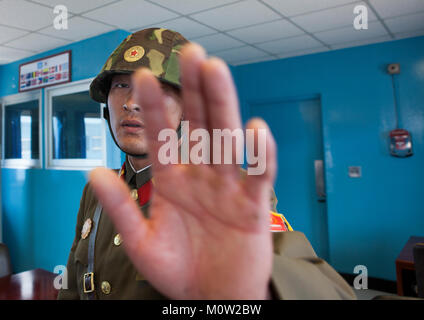 North Korean soldier refusing a picture in the conference room of the United Nations on the demarcation line in - Stock Photo