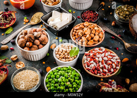 Set of organic healthy diet food, superfoods - beans, legumes, nuts, seeds, greens, fruit and vegetables. Dark blue - Stock Photo