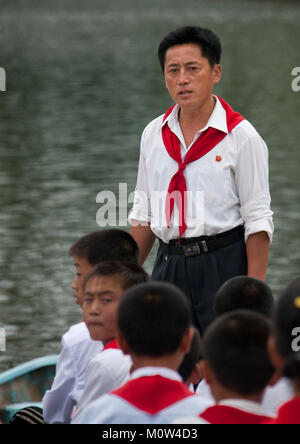 North Korean pioneers in a rowing boat with a leader in Songdowon international children's union camp, Kangwon Province, - Stock Photo