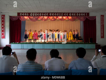 North Korean girl singing during a show for toursist in a school, Pyongan Province, Pyongyang, North Korea - Stock Photo