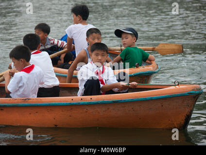 North Korean pioneers in rowing boats in Songdowon international children's union camp, Kangwon Province, Wonsan, - Stock Photo