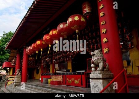 Altar at Siong Lim Buddhist Temple Singapore decorated with red lanterns and stone lion statues celebrating Chinese - Stock Photo