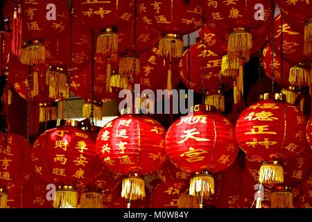 Traditional red and gold Chinese lanterns celebrating Chinese Lunar New Year in Chinatown Singapore - Stock Photo