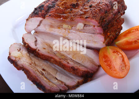 grilled pork chops with tomato and ketchup on plate. - Stock Photo