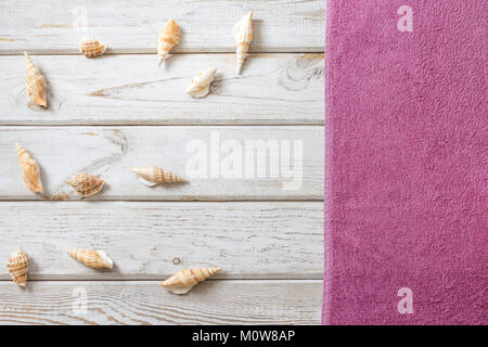 Beach towel and summer accessories on white wooden background. Travel concept. View from above. Blank mock up for - Stock Photo