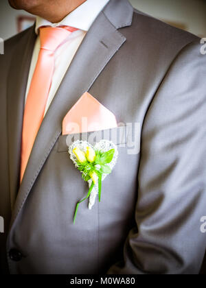 the modern jacket with cloth and flower decoration for wedding - Stock Photo