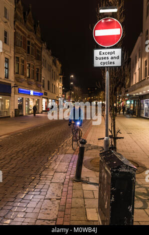 No Entry sign at a pedestrian shopping zone road at night in Worthing, West Sussex, England, UK. - Stock Photo