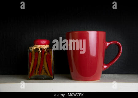 Jalapeno peppers and red cup - Stock Photo