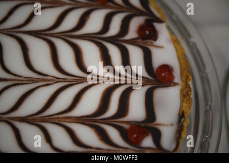 food photography of a home made Bakewell tart cake with short crust pastry frangipane and almonds with a chocolate - Stock Photo