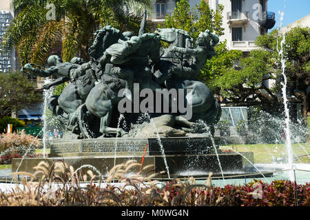Juan Pedro Fabini square (Plaza Juan Pedro Fabini) with historic memorial to heroes and fountain in Montevideo. - Stock Photo