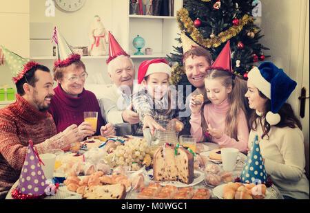 Large family enjoying festive meal during Christmas dinner - Stock Photo
