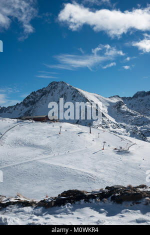A view towards the chair lifts and ski runs down the side of the mountain in Soldeu, Grandvalaria ski area, Andorra, - Stock Photo