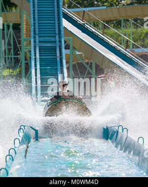 Mother and her daughter having fun in waterpark - Stock Photo