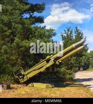 FINOWFURT, GERMANY - AUGUST 22, 2015: Old Soviet ground to air missiles, panoramic image made at old Soviet airfield - Stock Photo