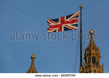 The Union Jack flag flying high above Westminster as the sun sets on the evening after the Brexit result which set - Stock Photo