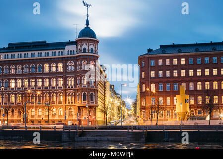 Helsinki, Finland - December 6, 2016: Crossroad Of Pohjoisranta And Kirkkokatu Street In Evening Or Night Illumination. - Stock Photo