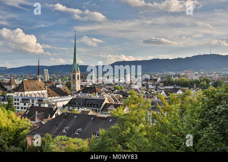Aerial view of Zurich city center with famous St. Peter Church and river Limmat at Lake Zurich from Grossmunster - Stock Photo